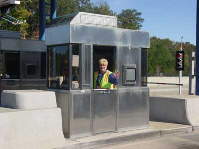 A toll worker waves from her booth on the Chesapeake Expressway - photo